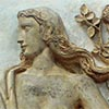Detail of plaster relief of figure of a woman